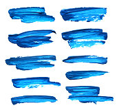 Set of blue abstract gouache brush strokes on a white background
