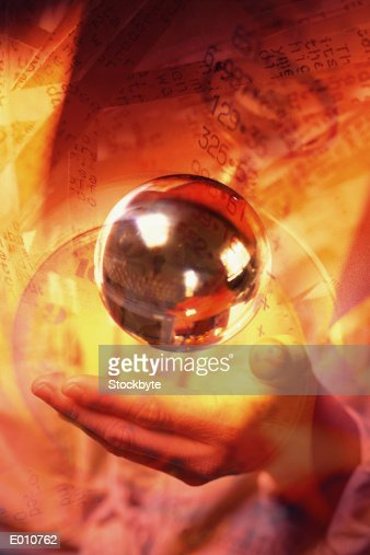 Shiny sphere floating above hand with financial numbers on orange : Stock Illustration