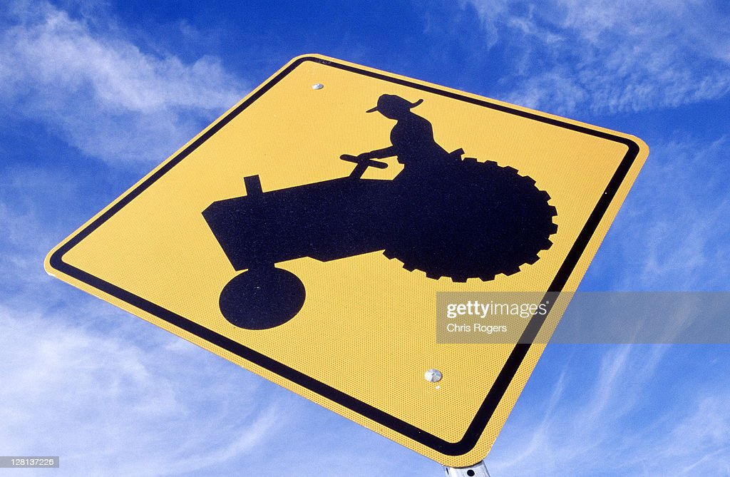 Sign of farmer in tractor : Stock Illustration