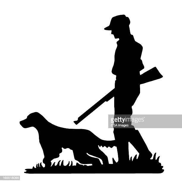 Silhouette of a Hunter and Dog