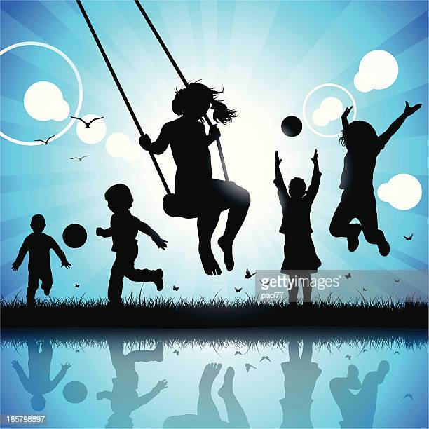 Silhouette of happy children playing and jumping