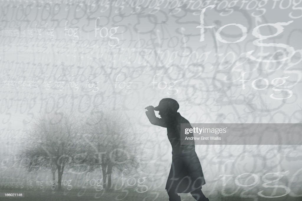 Silhouetted figure walking through foggy landscape : Stock Illustration