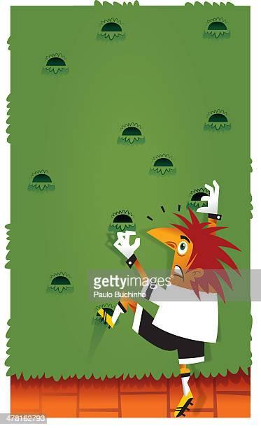 A soccer player climbing a wall