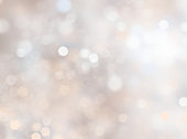 Beige grey soft blurred abstract lights winter background.Xmas defocused illustration.Shining elegant backdrop.