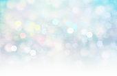 Colorful glitter blurred lights on white blue background.Xmas magic wallpaper.Horizon winter backdrop.Romantic illustration.
