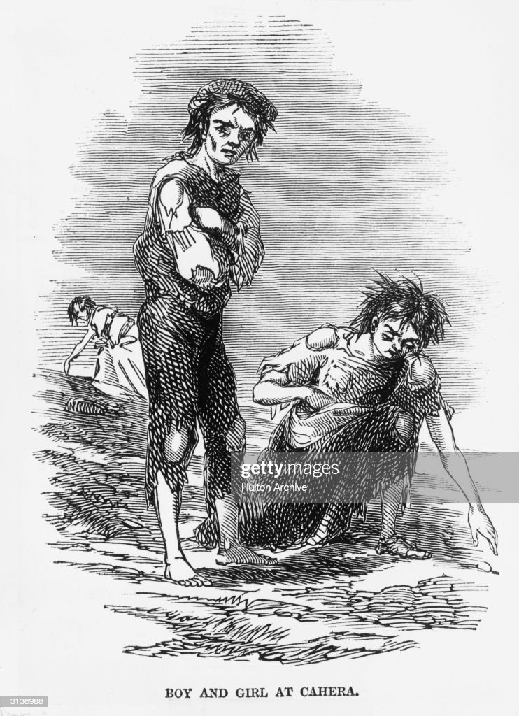 A starving boy and girl rake the ground for potatoes at Cahera during the Irish potato famine