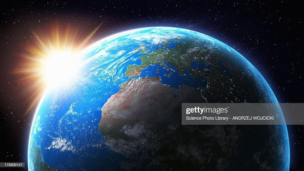 Sun setting behind Earth, artwork : Stock Illustration