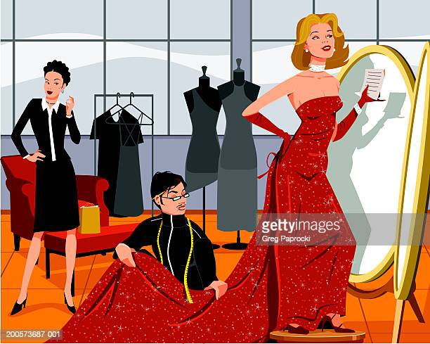 Tailor assisting woman with gown in retail store