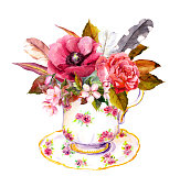 Boho chic tea cup design with rose flowers and vintage feathers. Watercolor for tea time