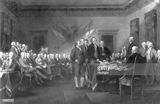 The American Declaration of Independence adopted by the Continental Congress in Philadelphia with the future 1st President of the United States of...