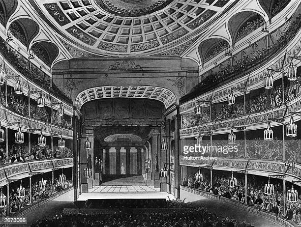 The auditorium and stage of the New Covent Garden Theatre in London better known as the Royal Opera House or Covent Garden Opera House Original...