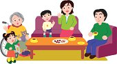 Three generation family sitting at table, enjoying tea time, high angle view