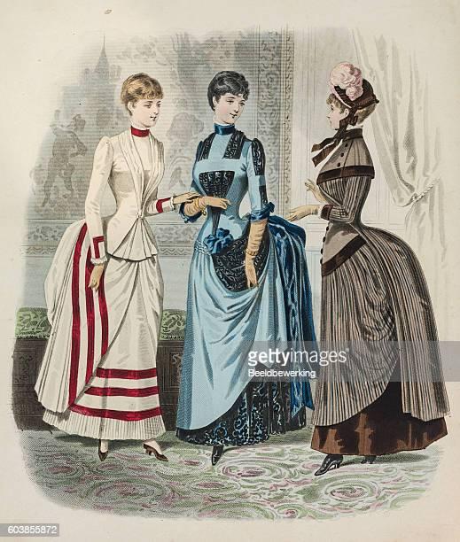 Three women showing different dresses with queue de Paris