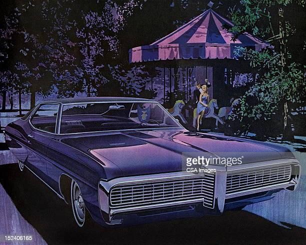 Vintage Car estacionada en el frente del tiovivo