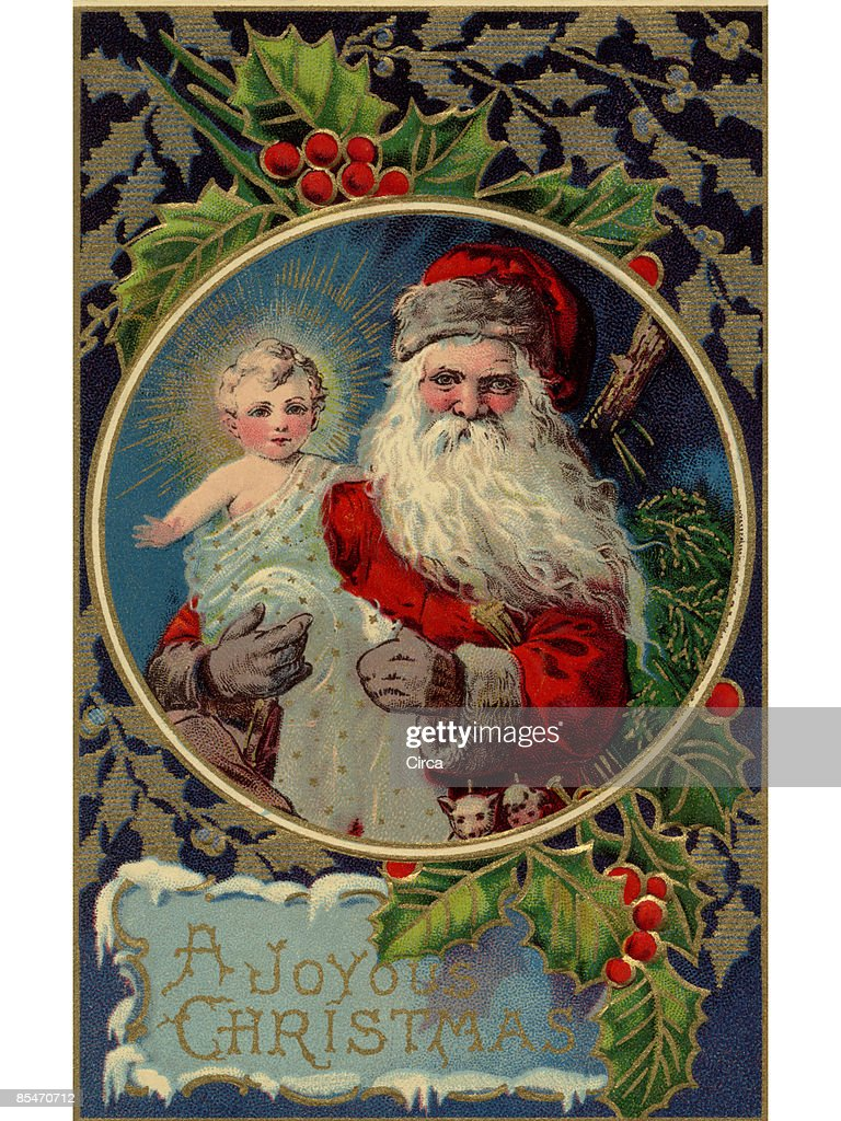 vintage christmas card of santa claus holding baby jesus stock