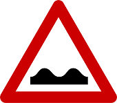 Warning sign with road bumps symbol