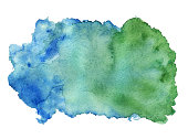 Watercolor blue green colors paint stain closeup isolated on a white background