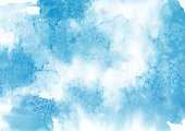 Blue watercolor splash with salt crystals on a white background