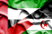 Waving flag of Western Sahara and United Arab Emirates