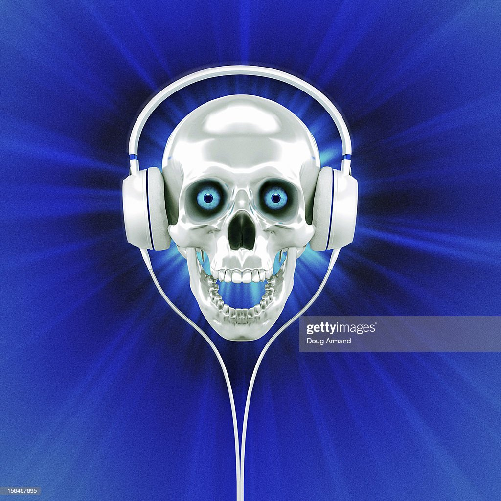 White human skull with headphones enjoying music : Stock Illustration