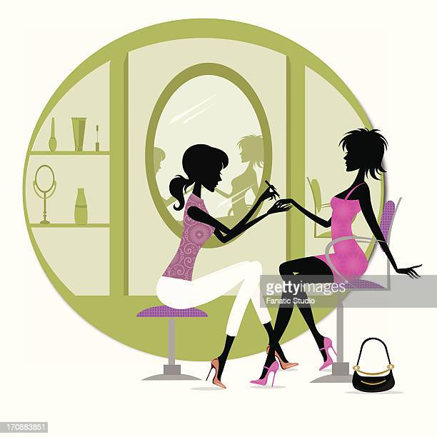 Woman getting a manicure treatment in a beauty parlor