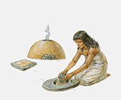 Woman grinding corn to make unleavened bread