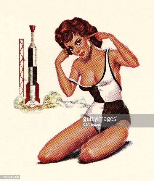Woman Plugging Ears With Rocket