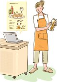 Woman standing and looking at recipe on internet, front view
