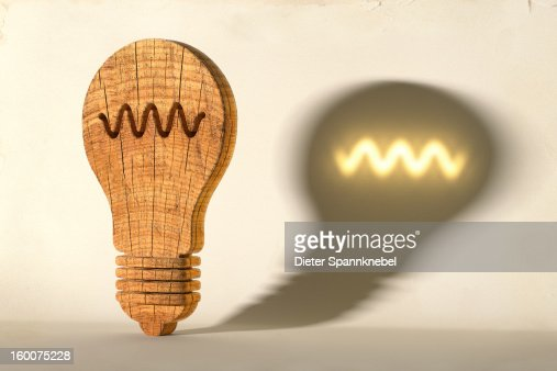 Wooden light bulb projects a glowing filament : Stock Illustration