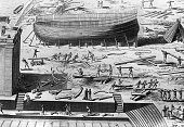 Workers constructing a large wooden vessel in a busy shipyard scene from Diderot's Pictorial Encyclopedia of Trades and Industry