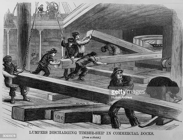 Workers discharging timber from a ship in a commercial dock Illustration from 'London Labour and London Poor' by Henry Mayhew in The Morning...