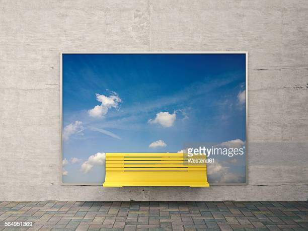 Yellow bench in front of billboard with sky and clouds