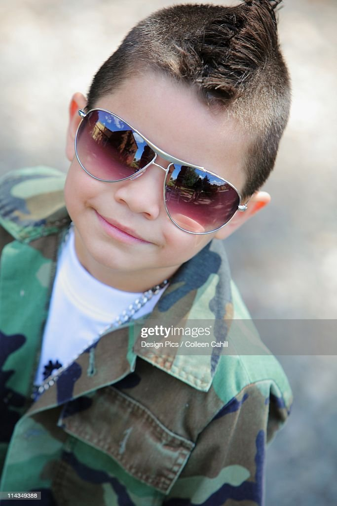 A Young Boy With A Mohawk And Sunglasses : Stock Illustration