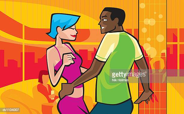 Young Couple Dancing in a Nightclub