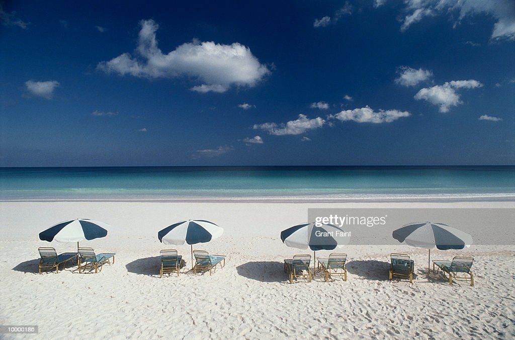 UMBRELLA & CHAIRS ON BEACH IN THE BAHAMAS : Stock Photo