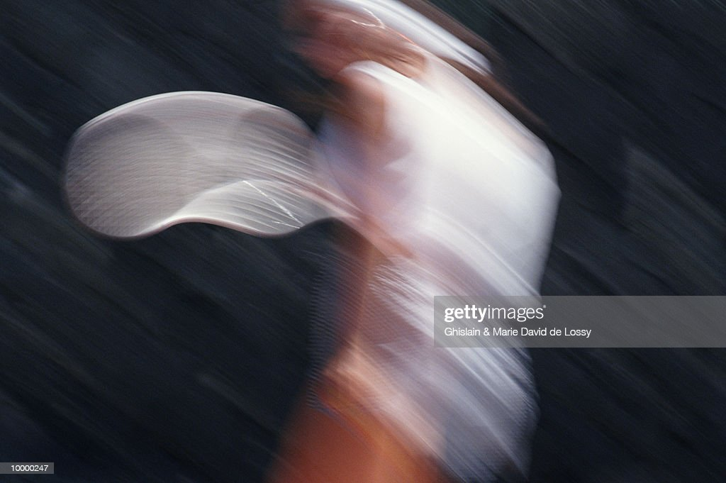 TENNIS PLAYER IN BLUR : Stock Photo