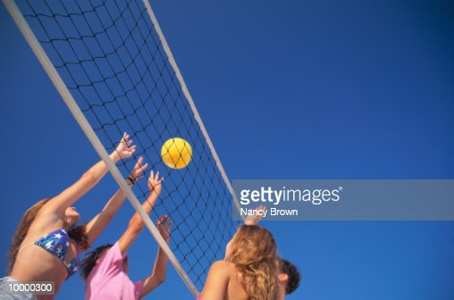 TEENS PLAYING VOLLEYBALL : Stock Photo