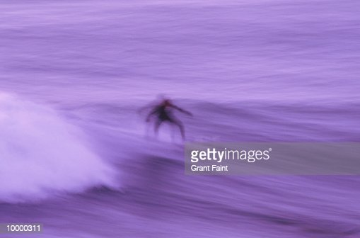 SURFER AT DUSK IN BLUR : Stock Photo
