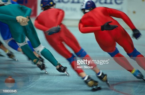 BACK VIEW OF SPEED SKATERS : Stock Photo