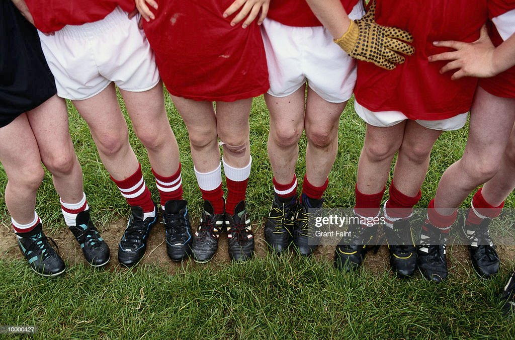 YOUNG SOCCER PLAYERS LEGS : Stock Photo