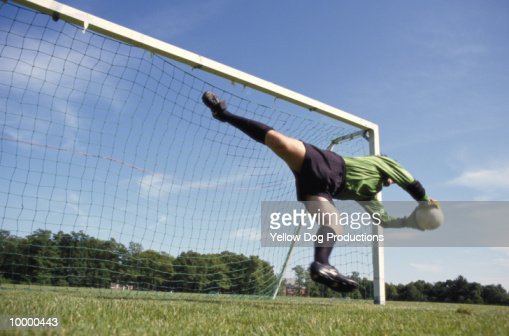 GOALIE DIVING FOR SOCCER BALL : Stock Photo