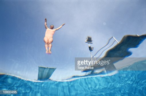 UNDERWATERVIEW OF A FEMALE DIVER IN MIDAIR : Foto stock