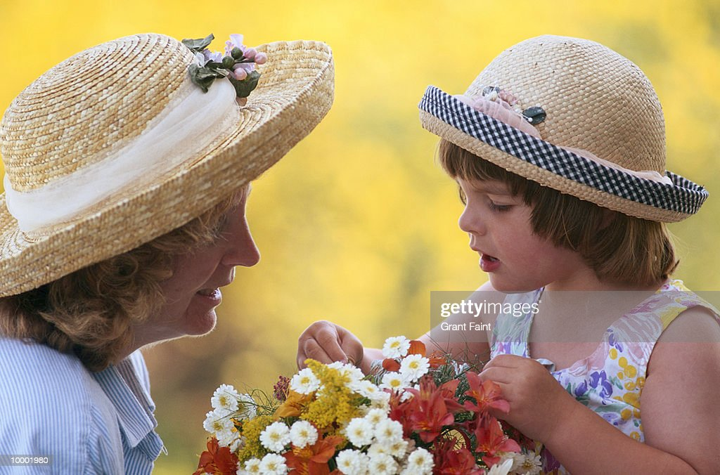 MOTHER & YOUNG GIRL IN HATS WITH FLOWERS : Stock Photo