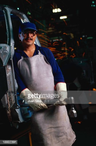 AUTO ASSEMBLY LINE WORKER WITH WRENCH : Stock Photo