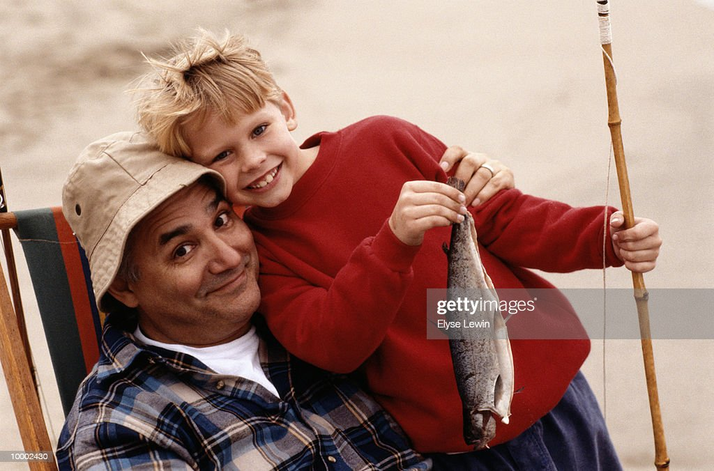 GRANDFATHER & BOY WITH FISH & POLE : ストックフォト