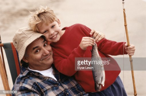 GRANDFATHER & BOY WITH FISH & POLE : Photo