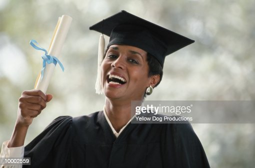 BLACK FEMALE GRADUATE HOLDING DIPLOMA : Stock Photo
