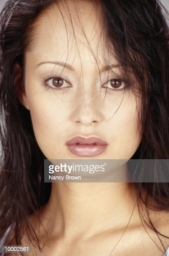 HAED SHOT OF AN ASIAN WOMAN WITH WET HAIR : Stock Photo