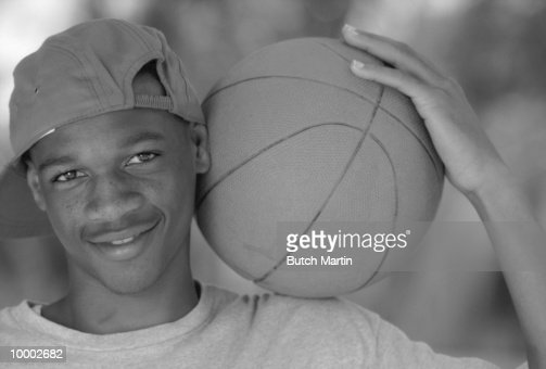 BLACK TEENAGE MALE WITH BASKETBALL IN BLACK AND WHITE : Photo