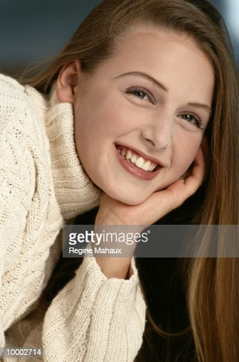 HEAD SHOT OF A TEENAGE GIRL IN SWEATER : Stock Photo